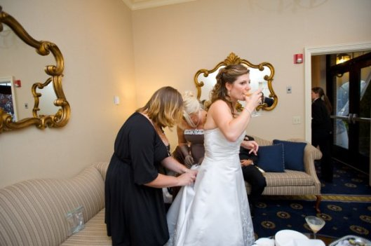 Sage fixing a bustle at the Gradview in Poughkeepsie