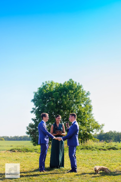Ceremony with a tree as a back drop