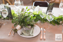 Luscious greenery for their table decor